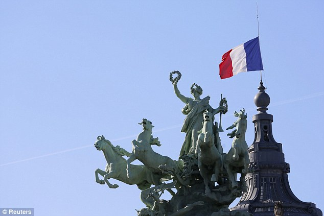 1411747421000_wps_3_the_french_flag_flies_at_